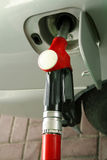 Red gas station nozzle Royalty Free Stock Photography