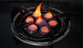 Red gas stove. With black background Stock Photography