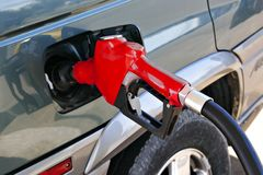 Red gasoline pump nozzle Royalty Free Stock Photos