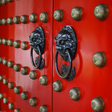 Red Gate. This is a very Chinese style gate with the lion door knockers and golden pins Royalty Free Stock Image
