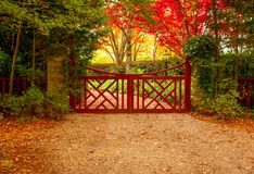 Free Red Gate And Autumn Colours Of Beautiful Gardens Stock Photos - 154579833
