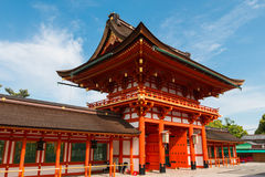 Red gate of Fushimi Inari shrine. Famous public temple in Japan in a sunny day Royalty Free Stock Photography
