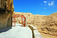 The red gate  on a mountain road Stock Image