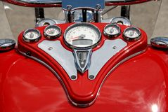 Red gauges on motorcycle. A red motorcycle with dashboard and gauges Stock Images