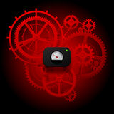 Red gear wheels of clockwork with Circular Meter on dark red bac Stock Photography