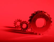 Red Gears. Three gears with red gel Stock Photos
