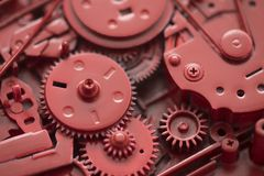 Red gears and cogs. Macro shot, industrial background stock image