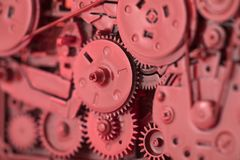 Red gears and cogs. Macro shot, industrial background stock photo