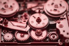 Red gears and cogs. Macro shot, industrial background Royalty Free Stock Photo