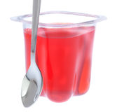 Red gelatin in a plastic bag with a spoon. Stock Photos