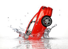 Red generic sedan car, falling into water splashing. Stock Images