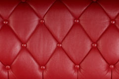 Red genuine leather upholstery Stock Photography
