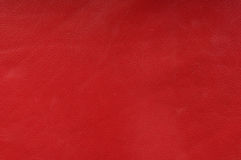 Red genuine leather upholstery. Texture background Royalty Free Stock Photography