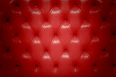 Red genuine leather upholstery. Closeup Royalty Free Stock Photo