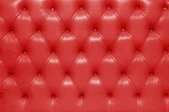 Red genuine leather upholstery. Closeup Stock Photography