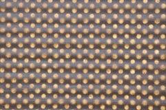 Red geométrica del peper de Brown con los agujeros Imagen de archivo libre de regalías