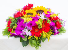 Red Gerbera flowers and Sunflowers on white table Stock Photos