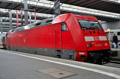 A red German electric railway engine parked at Munich station Royalty Free Stock Photos