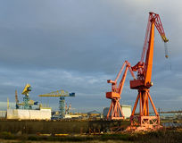 Red Giants. Red cranes at a shipyard Royalty Free Stock Images