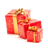 Red Gift. Red and golden gift on a white background royalty free stock image
