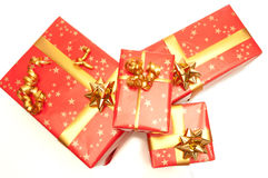 Red Gift. Red and golden gift on a white background stock images