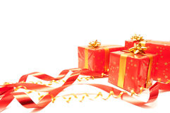 Red Gift. Red and golden gift on a white background stock photography