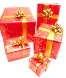Red Gift. Red and golden gift on a white background stock photos