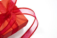 Red gift. Isolated on white background with nice red ribbon Stock Photos