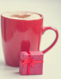 Red gift ahd cup of coffee Stock Images