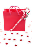 Red gift back and candy canes  Royalty Free Stock Images