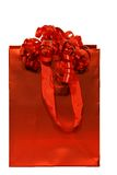 Red gift bag. Red party gift bag with curly bows Stock Photos