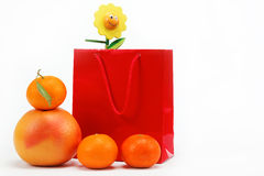 Red Gift Bag and citrus fruits on a white. Royalty Free Stock Photos