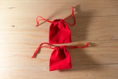 Red Gift Bag on Old Shabby Wooden Table concept Christmas and Newyear. Red Gift Bag on Old Shabby Wooden Table concept Christmas and Newyear Royalty Free Stock Image