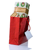 Red Gift Bag Overflowing With Christmas Presents. Royalty Free Stock Photos