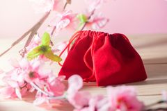 Red Gift Bag and plum blossom on Old Shabby Wooden Table concept Christmas and Newyear. Red Gift Bag and plum blossom on Old Shabby Wooden Table concept stock photography
