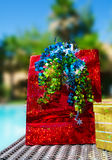 Red Gift bag with ribbon by the swimming pool Royalty Free Stock Image