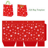 Red gift bag template with snowflakes. Winter gift bag with sparkles and snowflakes. Vector illustration of a bag and bag template Stock Images