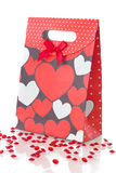 Red gift bag, on white. Red gift bad with pattern of hearts, on white background Royalty Free Stock Photography