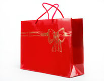 Red gift bag on a white background. Stock Image