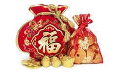 Red Gift Bags and Gold Ingots Royalty Free Stock Images