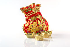 Red Gift Bags and Gold Ingots on White Stock Photography