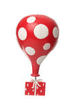 Red gift with balloon Stock Photography