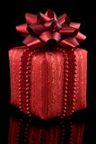 Red gift on black background Royalty Free Stock Image