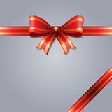 Red gift bow. Red gift bow on a gray background Stock Photography