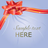 Red gift bow blue card Stock Photo