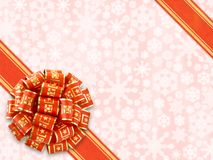 Red Gift Bow Over Snowflakes Background Stock Photo