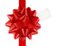 Red Gift Bow and Tag on White Box Royalty Free Stock Photography