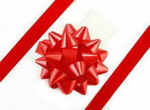 Red Gift Bow and Tag on White Box Royalty Free Stock Images