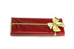 Red gift with a bow tied up by a ribbon. On the white isolated background Stock Photo