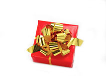 Red gift box. And golden rbbon isolated on white stock photography